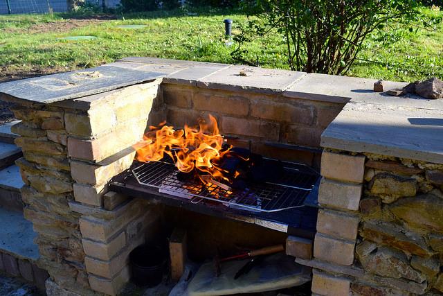 Lighting the barbecue   www.rachelphipps.com @rachelphipps