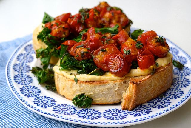 Hummus, Crispy Kale & Thyme Roasted Tomatoes on Sourdough Toast | www.rachelphipps.com @rachelphipps