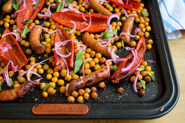 Easy One Pan Merguez with Red Peppers & Crispy Chickpeas #onepan #sheetpan #dinner #lamb #merguez #pepper #chickpeas